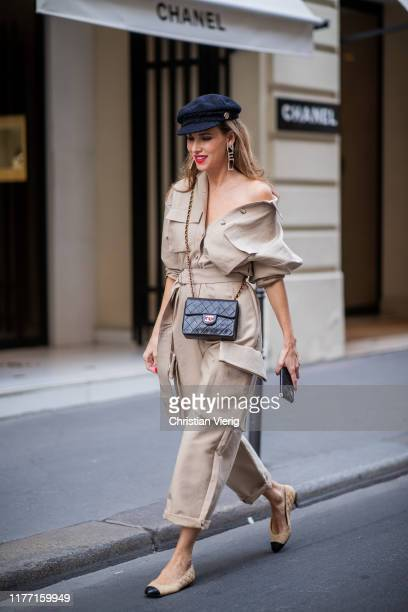 Alexandra Lapp is seen wearing a beige Frankie Shop jumpsuit, Chanel earrings, vintage Chanel classic bag, Chanel ballerinas, Chanel baker boy cap...