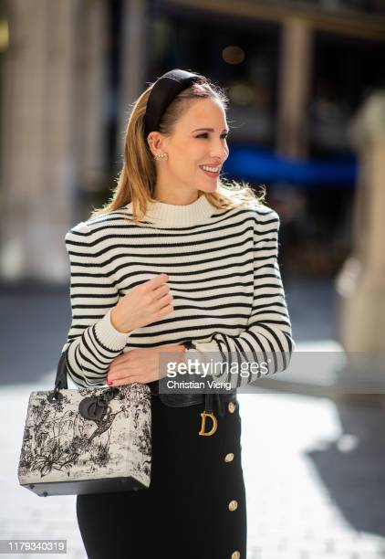 Alexandra Lapp is seen wearing a black and white striped pullover with shoulder pads from saint Laurent black pencil skirt with golden buttons from...