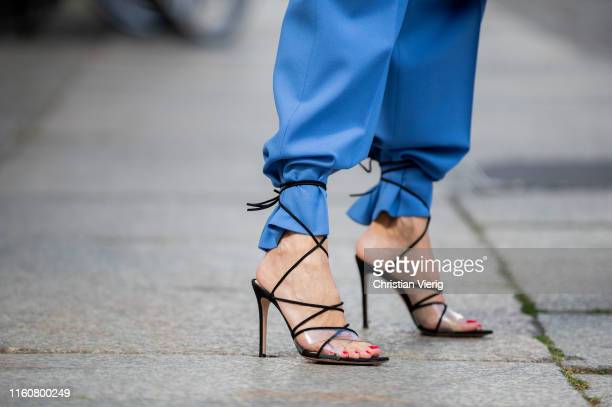 Alexandra Lapp is seen wearing a blue Zara suit black Gianvito Rossi Medea sandals with straps tied around the trouser leg during Berlin Fashion Week...