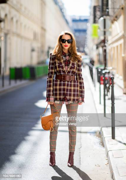 Alexandra Lapp is seen wearing a burgundy and yellow checked wool blazer from Burberry embroidered checked oversized shirt in red black white by...