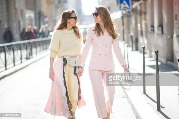 Alexandra Lapp is seen wearing a chunky knit sweater from Ganni a multi colored SelfPortrait plisseeskirt Saint Laurent Blanc Vi belt bag Celine...