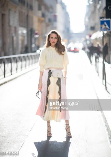 Alexandra Lapp is seen wearing a chunky knit sweater from Ganni a multi colored SelfPortrait plisséeskirt Saint Laurent Blanc Vi belt bag black...