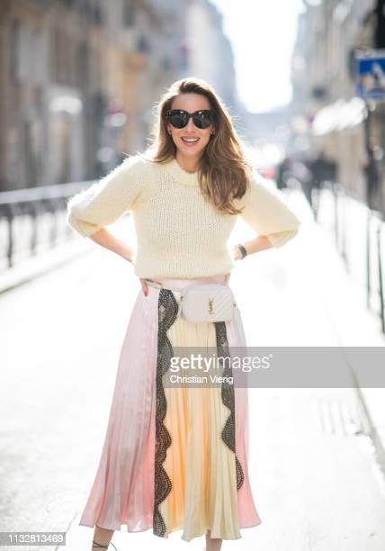 Alexandra Lapp is seen wearing a chunky knit sweater from Ganni a multi colored SelfPortrait plisséeskirt Saint Laurent Blanc Vi belt bag Celine...