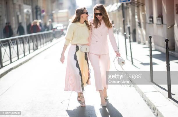 Alexandra Lapp is seen wearing a chunky knit sweater from Ganni a multi colored SelfPortrait plisseeskirt Saint Laurent Blanc Vi belt bag black...