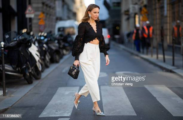 Alexandra Lapp is seen wearing a Corsage Embellished Bodice in black from Zimmermann black and white striped highwaist 7/8 length pants from Chloé...