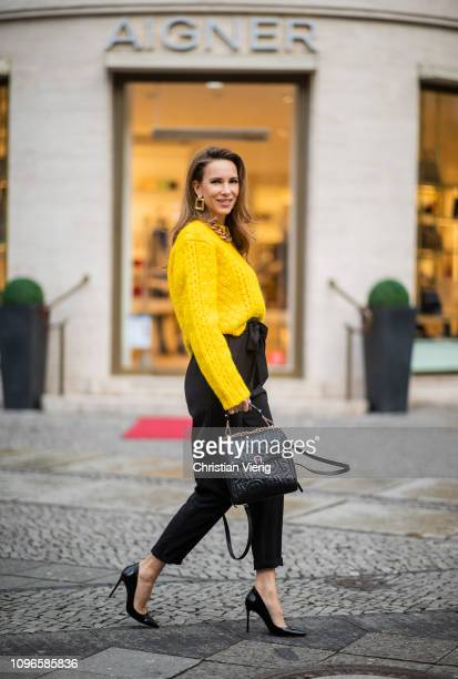 Alexandra Lapp is seen wearing a cropped yellow cable knit sweater from R13 with paperbag pants from HM Gianvito Rossi patent leather pumps Zara...