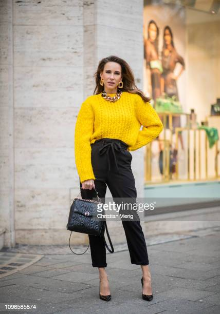 Alexandra Lapp is seen wearing a cropped yellow cable knit sweater from R13 with paperbag pants from H&M, Gianvito Rossi patent leather pumps, Zara...