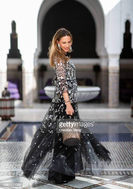 Alexandra Lapp is seen wearing a Dragonfly Garden embellished tulle and crepe de chine maxi dress in black and silver by Needle Thread black pumps...