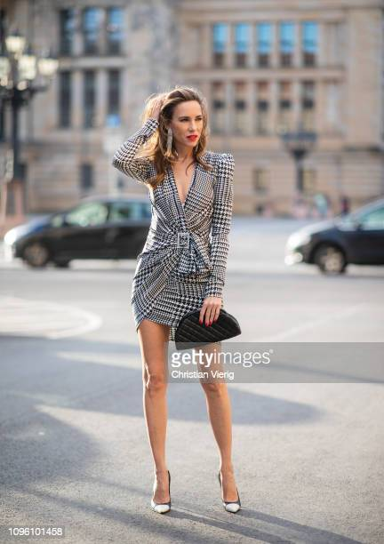 Alexandra Lapp is seen wearing a draped embellished satin mini dress in a checkered pattern with a crystal buckle from Alexandre Vauthier black pumps...