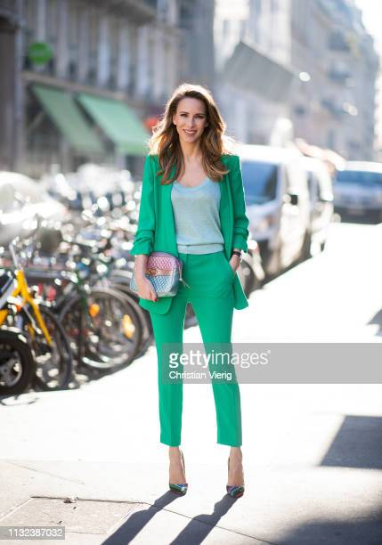 Alexandra Lapp is seen wearing a green suit combination by Steffen Schraut with a long blazer with a 3/4 length sleeve blazer and matching 7/8 length...