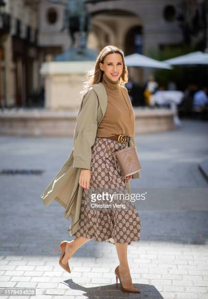 Alexandra Lapp is seen wearing a Gucci GG pleated jersey midi skirt, GG Marmont Mini-Bucket bag in nude, Christian Louboutin So Kate pumps in camel,...