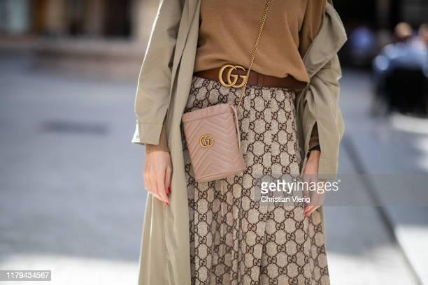 Alexandra Lapp is seen wearing a Gucci GG pleated jersey midi skirt GG Marmont MiniBucket bag in nude camel Nili Lotan sweater beige Zara trenchcoat...