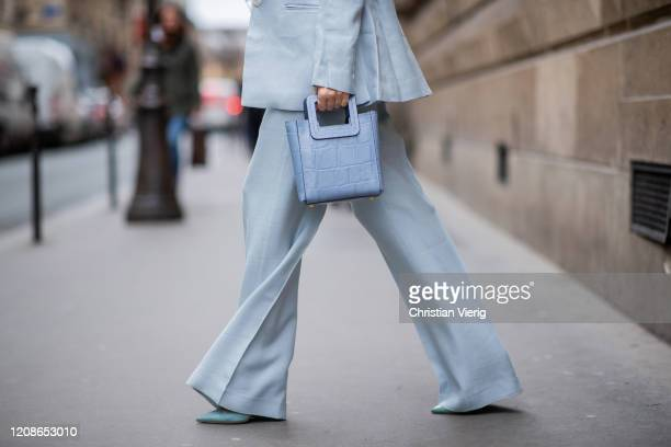 Alexandra Lapp is seen wearing a light blue De La Vali suit, blue Shirley mini bag from Staud, 16Arlington satin top with feathers, Prada pumps in...