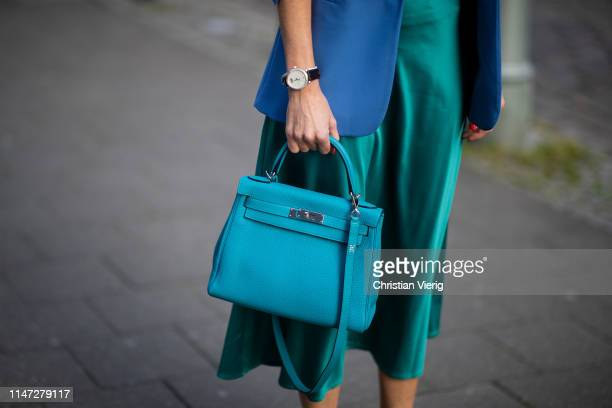 Alexandra Lapp is seen wearing a long turquoise satin skirt from Zara, a turquoise Hermès Kelly bag. On May 04, 2019 in Duesseldorf, Germany.