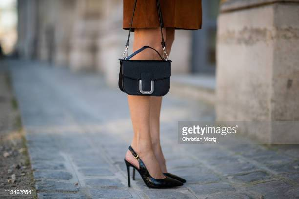 Alexandra Lapp is seen wearing a Marc Cain suede leather dress with a Marc Cain foulard a black mini bag and black crocoprint sling pumps both from...