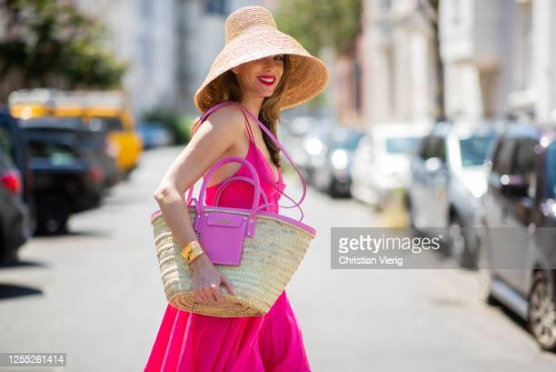 Alexandra Lapp is seen wearing a maxi dress La Robe Manosque from Jacquemus, hat Le Chapeau from Jacquemus, Tote Le Panier Soleil bag from Jacquemus...