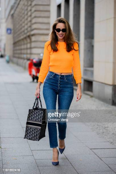 Alexandra Lapp is seen wearing a neon orange cropped sweater from Les Rêveries Adriano Goldschmied exboyfriend jeans Christian Louboutin So Kate...