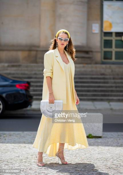 Alexandra Lapp is seen wearing a pale yellow oversized Zara blazer a yellow and white printed slipi dress from Zara Saint Laurent Inez leather...