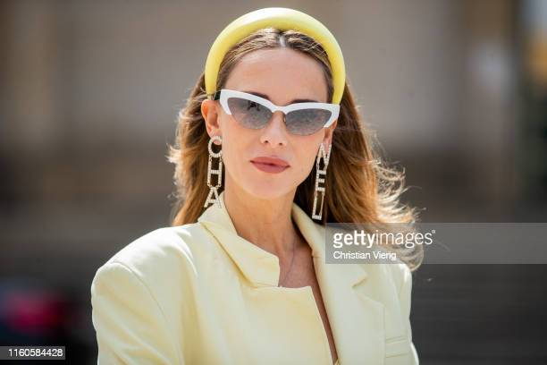 Alexandra Lapp is seen wearing a pale yellow oversized Zara blazer hair loop white miu miu cateye shaped sunglasses during Berlin Fashion Week on...
