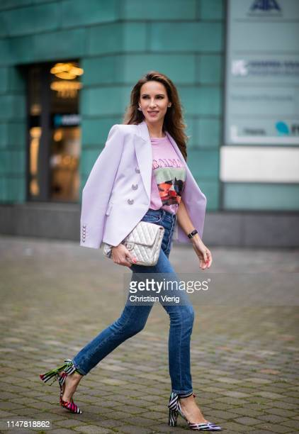 Alexandra Lapp is seen wearing a pastel lilac double breasted blazer from Balmain, a pastel t-shirt with a logo print from Balmain, high rise skinny...