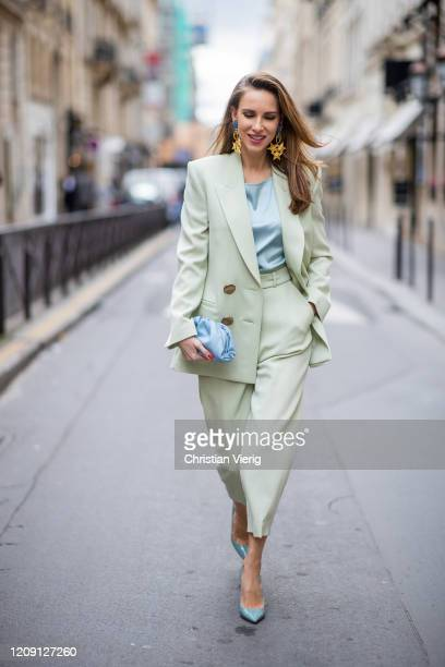 Alexandra Lapp is seen wearing a Petar Petrov double breasted slim fit blazer in mint color matching high waist pants from Petar Petrov light blue...