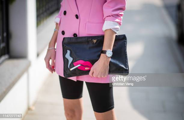 Alexandra Lapp is seen wearing a pink oversized blazer from Zara a logo print tshirt in black and white from Balenciaga biker / cycling shorts from...