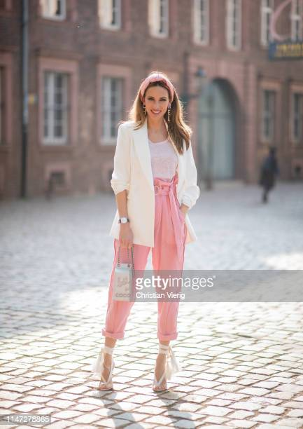 Alexandra Lapp is seen wearing a pink T-shirt from Isabel Marant, white smoking blazer from Zara, Harmony belted cotton tapered pants by IRO, Chanel...
