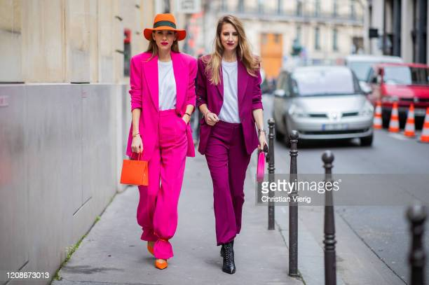 Alexandra Lapp is seen wearing a pink Zara suit with oversized blazer and high waist wide pants, oversized square-frame gold sunglasses from Kaleos,...
