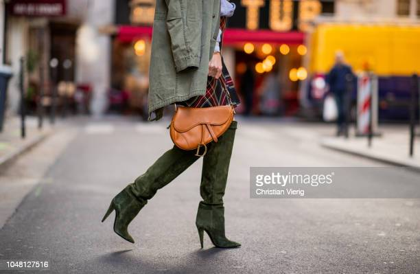 Alexandra Lapp is seen wearing a plaid kilt skirt from maje an I love Paris sweatshirt from a souvenir shop in Paris a green parka jacket with teddy...