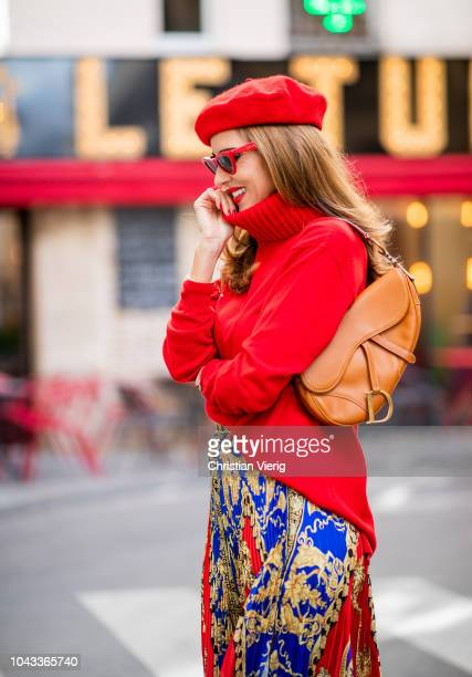 Alexandra Lapp is seen wearing a pleated printed midi skirt from Versace a long red cashmere turtle neck pullover from Falconeri a vintage Dior...