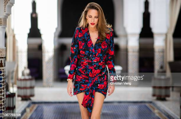 Alexandra Lapp is seen wearing a red and blue floral print silk mini dress with internal shoulder pads from Saint Laurent and black pumps from...