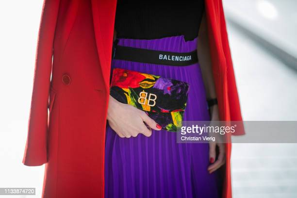 Alexandra Lapp is seen wearing a red Givenchy long coat a purple Balenciaga plissee skirt Offwhite stretch top and Balenciaga BB printed velvet...