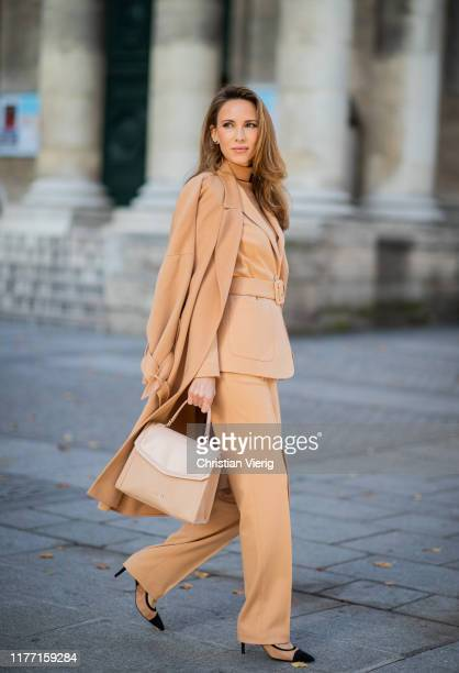 Alexandra Lapp is seen wearing a toffee colored total look from Marc Cain with belted blazer and wool-cashmere coat, bag and shoes during Paris...