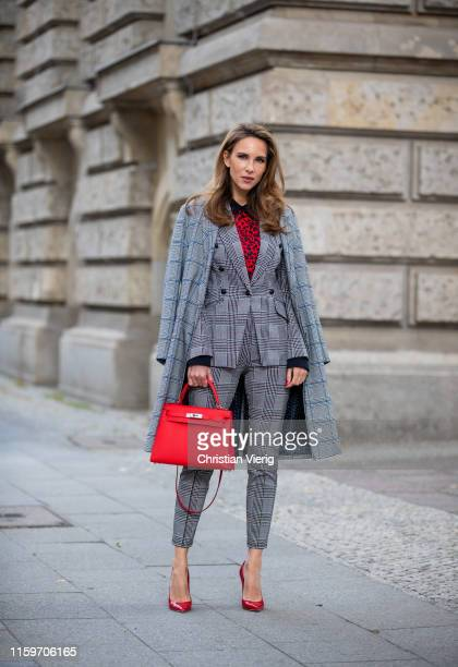Alexandra Lapp is seen wearing a total look by Steffen Schraut with grey checkered coat grey checkered suit and red leopard blousered Hermès Kelly...