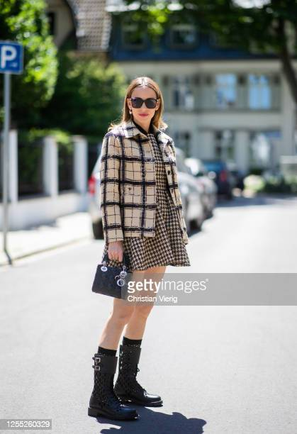 Alexandra Lapp is seen wearing a total look from the Dior 2020 summer collection DTrap Ankle Boots from Dior and Lady Dior bag in black on July 09...