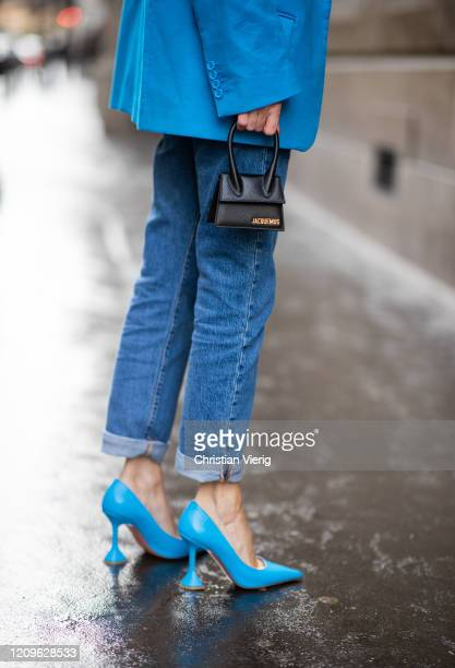 Alexandra Lapp is seen wearing a turquoise oversized jacket from The Attico, turquoise pumps from Amina Muaddi, 501 Levi's, Jacquemus Tote Le...