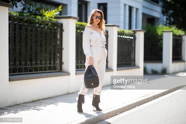 Alexandra Lapp is seen wearing a white American Vintage denim overall black fringed Malone Souliers Presley boots big black Chanel backpack black...