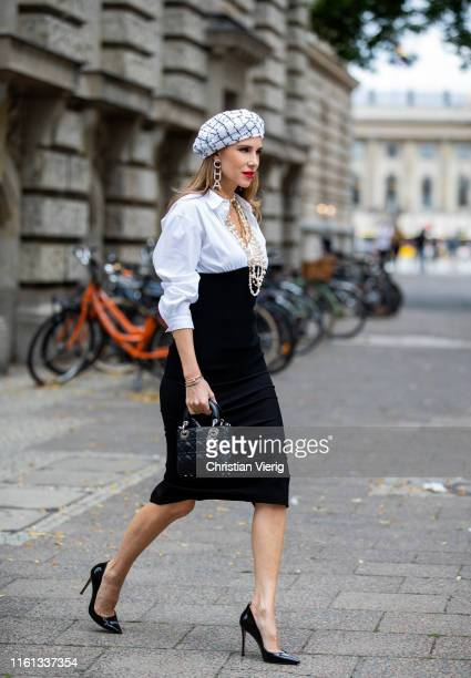 Alexandra Lapp is seen wearing a white blouse with black knitted bottom from Steffen Schraut tight black Offwhite pencil skirt black Gianvito Rossi...