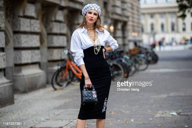 Alexandra Lapp is seen wearing a white blouse with black knitted bottom from Steffen Schraut tight black Offwhite pencil skirt white Chanel tweed...