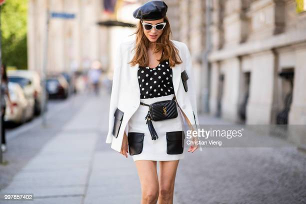 Alexandra Lapp is seen wearing a white Crepe blazer with black leather utility pockets and a white Crepe skirt with black leather utility pockets by...