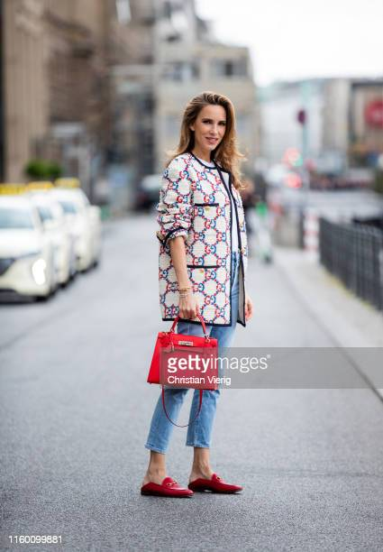 Alexandra Lapp is seen wearing a white Gucci Sylvie tweed jacket red Gucci Princeton slippers red Hermès Kelly bag white tshirt light blue citizens...