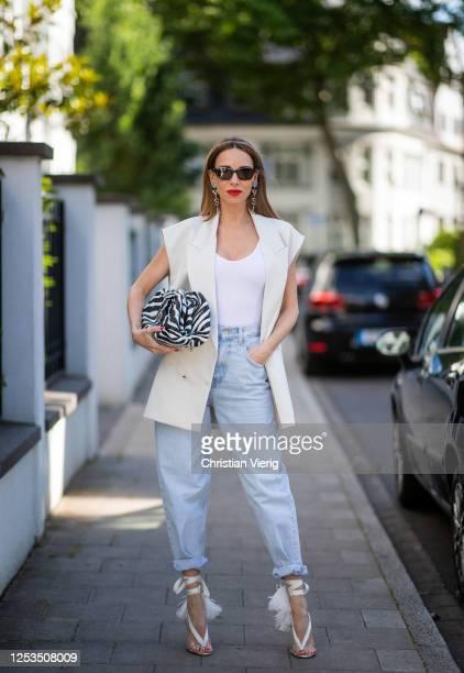 Alexandra Lapp is seen wearing a wide leg, high waist ballon jeans from Zara, white Zara oversized blazer without sleeves, Christian Louboutin...