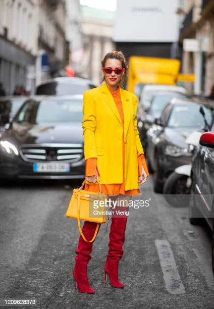 Alexandra Lapp is seen wearing Alexander McQueen orange long silk blouse worn as a dress, yellow oversized long House of Holland blazer, red...