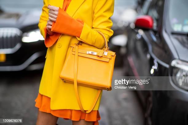 Alexandra Lapp is seen wearing Alexander McQueen orange long silk blouse worn as a dress, yellow oversized long House of Holland blazer, yellow 28...