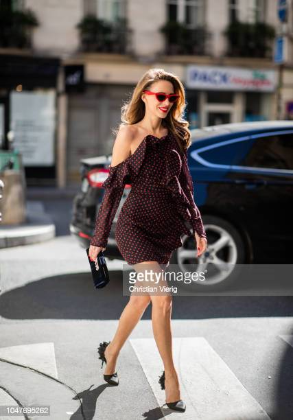 Alexandra Lapp is seen wearing an Oneshoulder ruffled fil coupe chiffon mini dress by SelfPortrait black leather heels black sequined in the back...