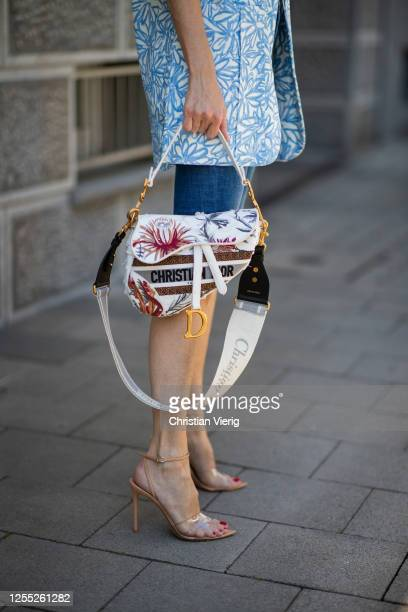 Alexandra Lapp is seen wearing an oversized blazer 'Veste d'Homme' from Jacquemus, Jeans shorts from Levi's, Gianvito Rossi plexi sandals, white body...
