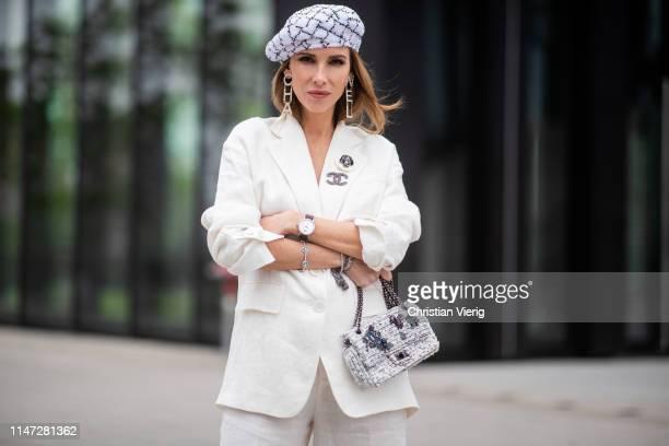 1fdcea4c9f01 Alexandra Lapp is seen wearing an oversized linen Zara suit with Chanel  broaches long stress earrings