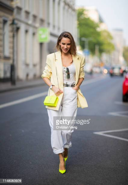Alexandra Lapp is seen wearing an oversized yellow Zara blazer Isabel Marant Etoile Lorny highrise oversized jeans in white white tank top by James...