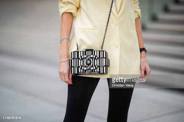 Alexandra Lapp is seen wearing an oversized yellow Zara blazer with black cycling/ biker leggings from HM and a white James Perse tank top Chanel...