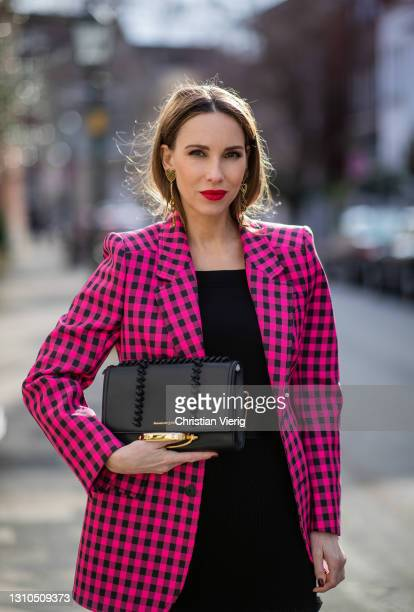 Alexandra Lapp is seen wearing BALENCIAGA checked Hourglass blazer in pink and black, ALEXANDER MCQUEEN off-shoulder knitted top in black, ALEXANDER...